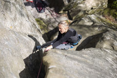 Athlete climbs on rock with rope. stock images