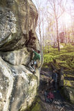 Athlete climbs on rock with rope. stock photo