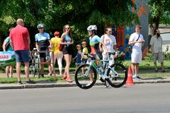 The athlete compete in cycling component during International triathlon competition stock photos
