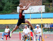Athlete compete in long jump Royalty Free Stock Images