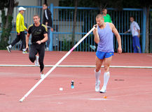 Athlete compete in pole vault Stock Images