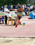 Athlete compete in triple jump Stock Photo