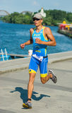 Athlete competing at the triathlon race Royalty Free Stock Photo