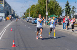 Athlete competitor and man who shoot him on video in the last phase of the Run for Life competition during City Day local activity Royalty Free Stock Photography