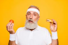Athlete cool uncertain unsure ponder fit picky grandpa holds for stock images