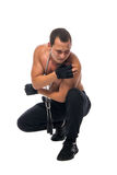 Athlete crouched down due to shoulder pain Stock Photo