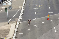 An athlete cycles in the Cologne Royalty Free Stock Photography
