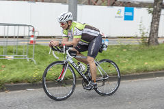 An athlete cycles in the Cologne Royalty Free Stock Image