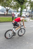 An athlete cycles in the Cologne Stock Images