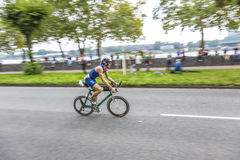 An athlete cycles in the Cologne Stock Image