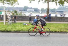 An athlete cycles in the Cologne Stock Photography