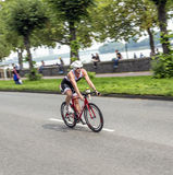 An athlete cycles in the Cologne Royalty Free Stock Photos