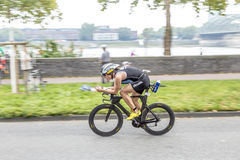 An athlete cycles in the Cologne Stock Photos