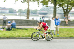 An athlete cycles in the Cologne Royalty Free Stock Photo