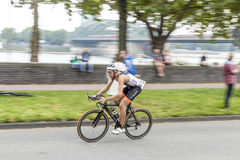 An athlete cycles in the Cologne Royalty Free Stock Images