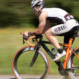 Athlete cycling. In a triathlon competition Royalty Free Stock Photo