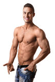 Athlete in denim trousers Royalty Free Stock Photo