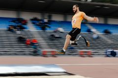 Athlete disabled amputee long jump. Athletics competition Royalty Free Stock Photos