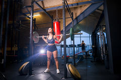 Athlete does squats with barbell royalty free stock photos