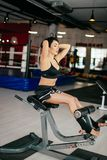 Athlete doing abs on sport gear at fitness club. Nice athlete doing abs on sport gear at fitness club.training routine.endurance Royalty Free Stock Images