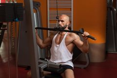 Athlete Doing Heavy Weight Exercise For Back Royalty Free Stock Images