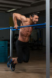 Athlete Doing Heavy Weight Exercise On Parallel Bars Stock Photography
