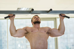 Athlete doing pull-ups Stock Image