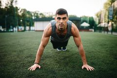 Athlete doing push-up exercise on outdoor workout royalty free stock images