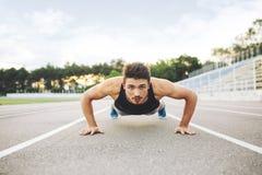 Athlete doing Push-ups Stock Image