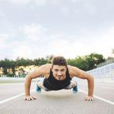 Athlete doing Push-ups Stock Images