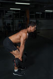 Athlete doing strength exercises with dumbbells royalty free stock photography