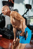 Athlete doing triceps workout in gym Stock Images