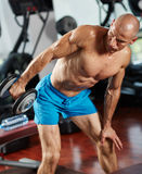 Athlete doing triceps workout in gym Royalty Free Stock Photos