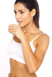 Athlete Drinking Water. An attractive young lady drinks a refreshing glass of water Royalty Free Stock Photo