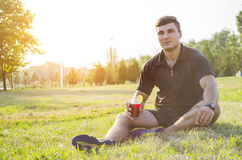 The athlete drinks water Royalty Free Stock Images