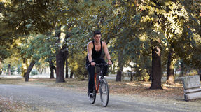 Athlete driving bicycle in outdoors nature for cardio training royalty free stock photos