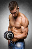 Athlete with dumbbell Stock Photography