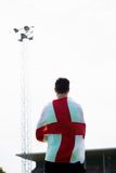 Athlete with england flag wrapped around his body. In stadium Royalty Free Stock Photography