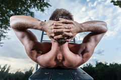 Athlete excercises abdominal muscles Royalty Free Stock Photography