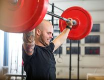 Athlete Exercising With Barbell At Gym Royalty Free Stock Images