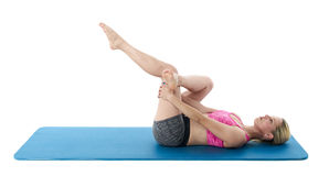 Athlete exercising on blue mat Royalty Free Stock Photography
