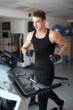 Athlete exercising on a stationary bike Stock Photo