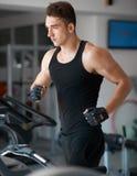 Athlete exercising on a stationary bike Royalty Free Stock Images