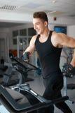 Athlete exercising on a stationary bike Royalty Free Stock Photo