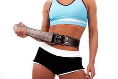 Athlete fastening belt Stock Photo