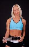Athlete fastening her belt Stock Photos