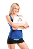Athlete female holding a weight scale Stock Image