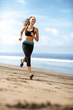 Athlete female running on sunny day Royalty Free Stock Photography