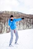 Athlete fighter doing a practice training on snow, exercising Royalty Free Stock Photo