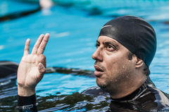 Athlete Finishing the Exit Protocol with the Okay Hand Sign Stock Image